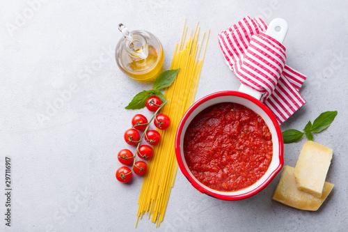 Fotografie, Obraz  Traditional tomato sauce in saucepan with spaghetti pasta