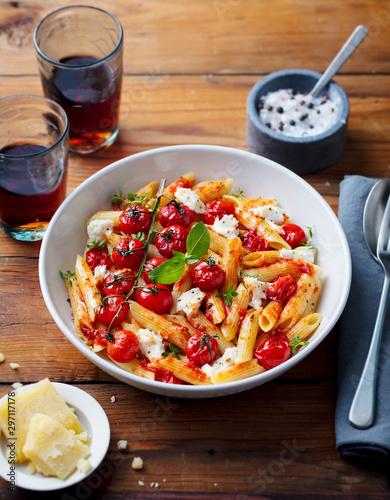 Obraz na plátně  Pasta penne with roasted tomato, sauce, mozzarella cheese and glass wine