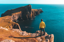 Man Standing On Top Of A Cliff...