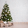 Leinwanddruck Bild decorated christmas tree, heap of gift boxes and copy space over white brick wall