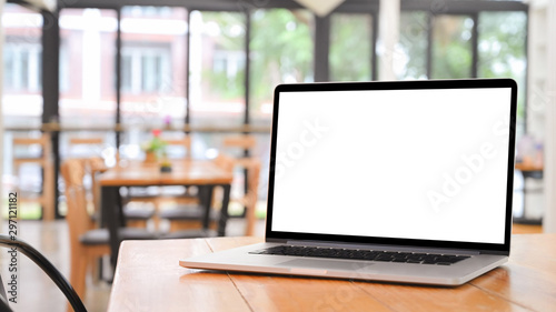 Obraz Laptop computer on wooden table with empty screen. - fototapety do salonu