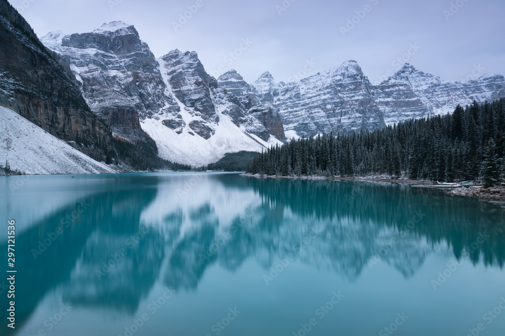 Fototapeta First snow Morning at Moraine Lake in Banff National Park Alberta Canada Snow-covered winter mountain lake in a winter atmosphere. Beautiful background photo