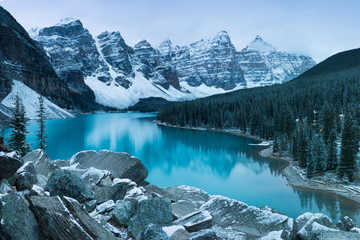First snow Morning at Moraine Lake in Banff National Park Alberta Canada Snow-covered winter mountain lake in a winter atmosphere. Beautiful background photo