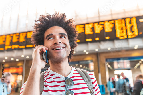 Pinturas sobre lienzo  Happy man on the phone at train station in London
