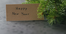 Happy New Year Card Next To Sp...