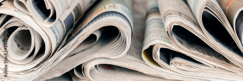 Newspapers, world news information concept, close-up, panoramic Canvas Print