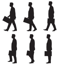 Silhouette Of Business Walking...