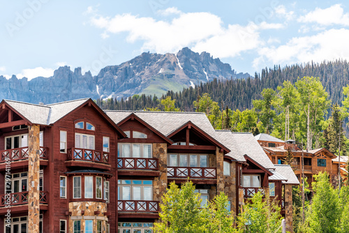 Obraz Telluride, Colorado small town Mountain Village in summer 2019 with view of San Juan Mountains and modern resort lodge apartment condo architecture - fototapety do salonu
