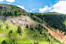 View Of Lush Green Mountain Alpine Meadow And Blue Sky Clouds Near Ouray, Colorado With San Juan Rocky Mountains In Summer From Million Dollar Highway