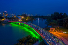 Aerial View Of Starlight Bridge Or Anh Sao Bridge Which Is A Pedestrian Bridge With Colored Lights And Waterfall In District 7 Of Ho Chi Minh City Also Known As Saigon, Vietnam.