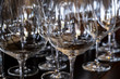 canvas print picture Closeup of Empty Wine Glasses in Various Shapes on a Bar Table