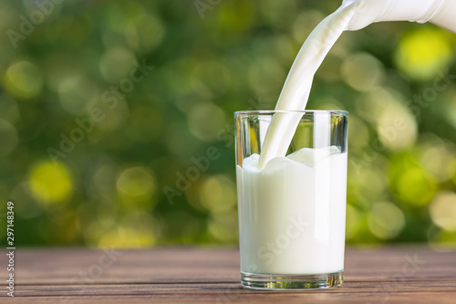 Stampa su Tela milk from jug pouring into glass