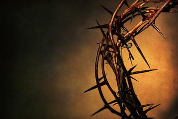 Crown of thorns on a ancient dark background.