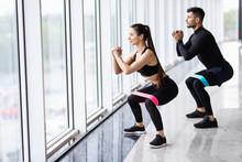Attractive Couple Exercising W...