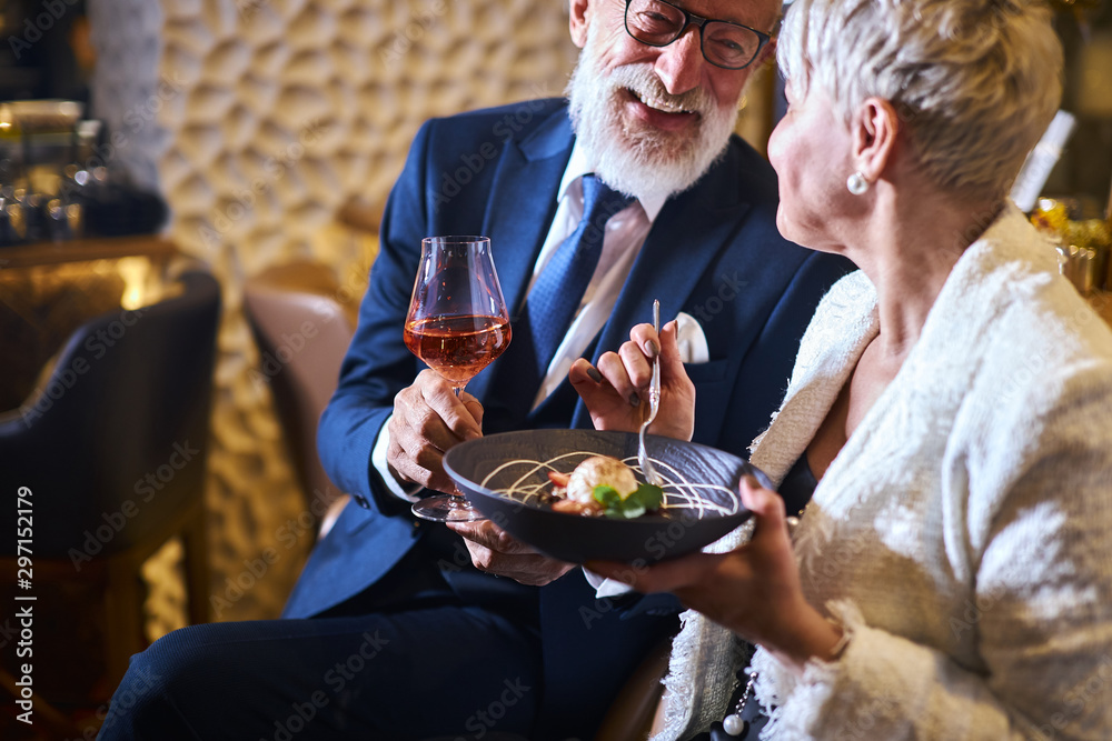 Fototapety, obrazy: Caucasian man in suit and eyeglasses, beautiful woman in white elegant blazer enjoy meal in attractive place. Sweet dessert and glass of champagne. Love in the air