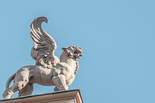 Roof Top Statue Of A Sphynx, Lion With Wings In Vienna Downtown At Blue Sky, Austria