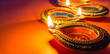 Leinwanddruck Bild - Indian festival Diwali, Diya oil lamps lit on colorful rangoli. Hindu traditional. Happy Deepavali. Copy space for text.