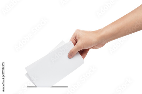 Fototapeta  Hand putting a ballot in to the voting box, isolated on white background