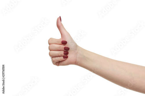 Fotografie, Tablou  Female hand with a beautiful manicure showing thumbs up sign, isolated on white background