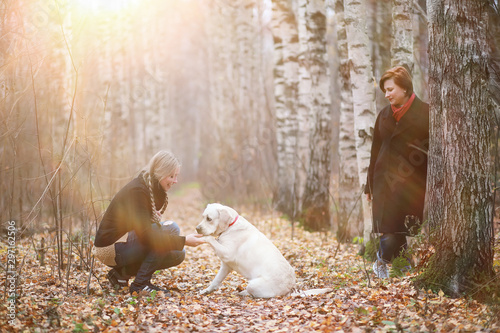 Foto  Young girl on a walk in the autumn