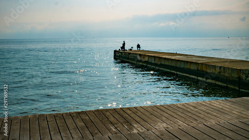 wooden promenade with a pier on a warm autumn day Canvas Print