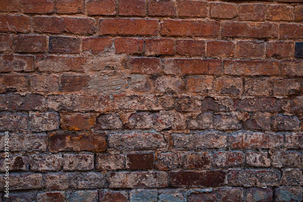 Fototapeta Texture of old brickwork with peeling color paint