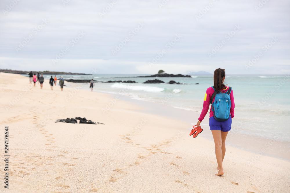Fototapety, obrazy: Galapagos Islands - woman on cruise ship tour visiting Playa las Bachas Beach on Santa Cruz Island. Woman walking barefoot in sand enjoying pristine nature landscape ecotourism