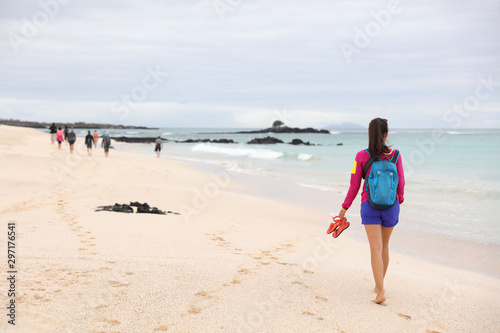 Wall Murals Personal Galapagos Islands - woman on cruise ship tour visiting Playa las Bachas Beach on Santa Cruz Island. Woman walking barefoot in sand enjoying pristine nature landscape ecotourism