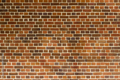 Photo Reddish brown color vintage brick wall texture with a quilted look, showing fain