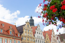 Wroclaw Central Market Square With Old Colourful Houses. Flowers In The Foreground. Summer Day. Travel, Vacation, Arhitectura Concept.