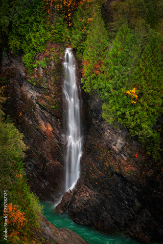 Beautiful Waterfall Behind Baker Lake Dam in the Mt. Baker National Forest. This waterfall can be seen as you cross the road atop the Baker Lake Dam seen here during the autumnal season.
