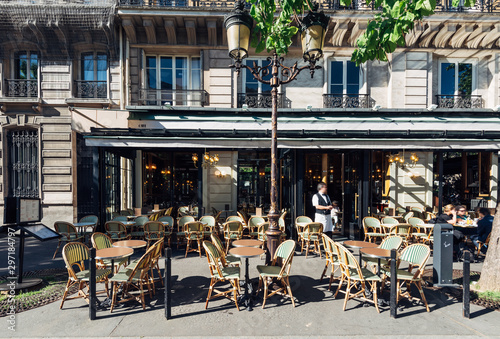 Poster Amsterdam Typical view of the Parisian street with tables of brasserie (cafe) in Paris, France