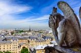 Fototapeta Fototapety Paryż - Gargoyle on Notre Dame de Paris on background of skyline of Paris, France.
