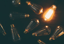 Glowing Bulb. Idea, Uniqueness, Leadership And Different Concept.