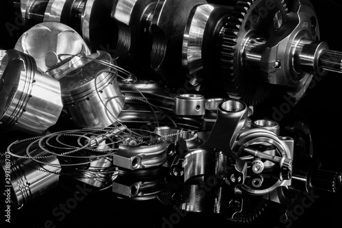 high performance racing motorcycle engine parts on a black reflective background Canvas Print