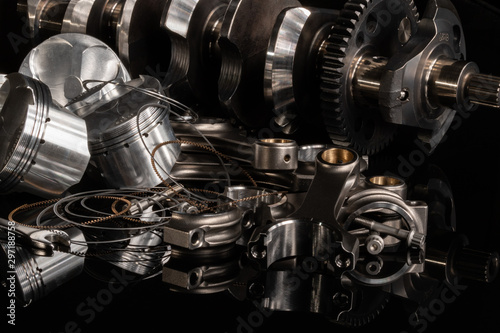 Fotografía  high performance racing motorcycle engine parts on a black reflective background