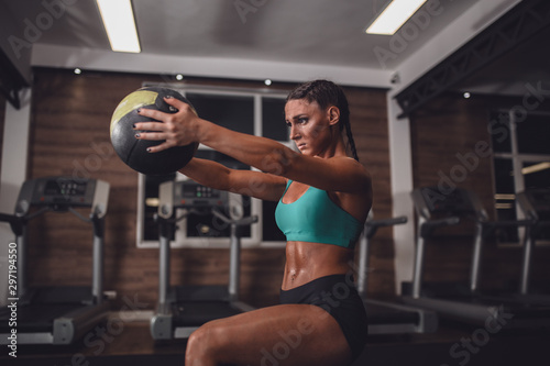Fényképezés  Fit girl in the gym with medicine ball