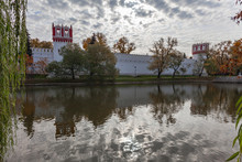 Walls And Towers Of The Novodevichy Convent, Reflected In The Water Of The Lake