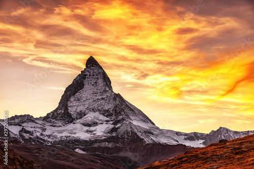 Montage in der Fensternische Orange Matterhorn mountain peak, Switzerland, seasonal autumnal scene. Epic sunset view on Matterhorn mountain peak in Switzerland over Riffelsee lake. Sun glowing during sunset. Swiss mountain landscape.
