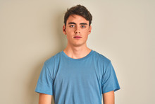 Teenager Boy Wearing Casual T-shirt Standing Over Isolated Background With Serious Expression On Face. Simple And Natural Looking At The Camera.