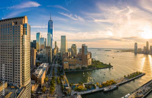 Fototapeta Aerial view of Lower Manhattan skyline at sunset viewed from above West Street in Tribeca neighborhood. obraz