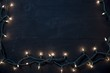 Overhead shot of tree lights over a black wooden surface