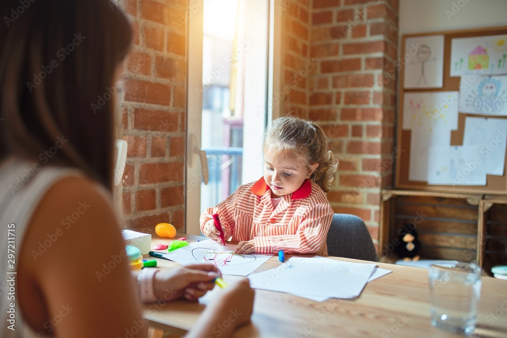 Fototapety, obrazy: Beautiful teacher and blond student toddler girl wearing school uniform drawing draw using colored pens at kindergarten