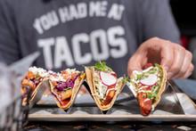 Man Eating Tacos In Summer