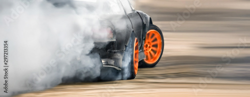 Photographie Race drift car burning tires on speed track