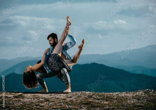 Two modern dancers practicing dancing on the mountain cliff - 297214307