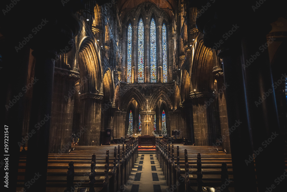 Fototapety, obrazy: GLASGOW, SCOTLAND, DECEMBER 16, 2018: Magnificent perspective view of interiors of Glasgow Cathedral, known as High Kirk or St. Mungo, with huge stained glasses. Scottish Gothic architecture.