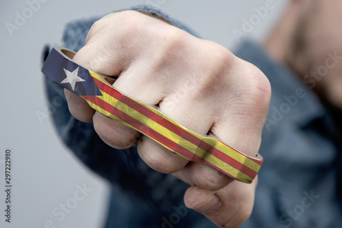 Vászonkép  Brass knuckles with the flag of Catalonia, protesters cause serious injuries