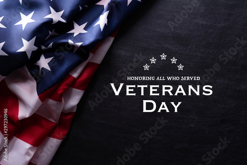 Obraz Happy Veterans Day. American flags with the text thank you veterans against a blackboard background. November 11. - fototapety do salonu