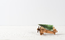 Christmas Background With Rustic Vintage Wooden Airplane Toy And Pine Tree. Decoration & Ornament Merry Christmas And Happy New Year Concept.